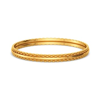 The Tweed Trove Gold Bangles